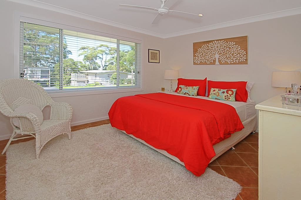 2 Bedrooms have beautiful views out to the bush and beach.