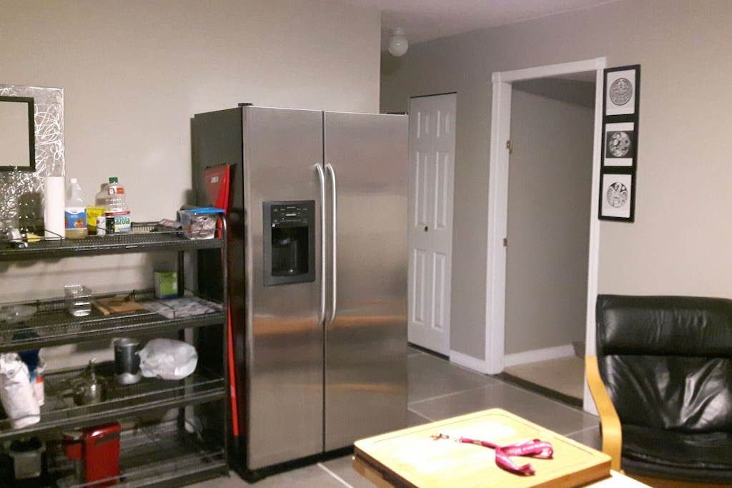 Kitchen rack and fridge including cooking essentials with whatever you may need to make a meal.
