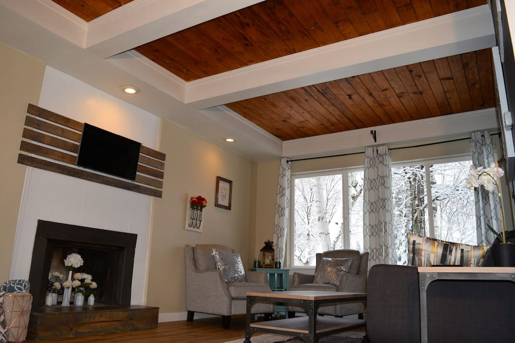 Original tongue and groove ceilings add warmth and character to the living room.
