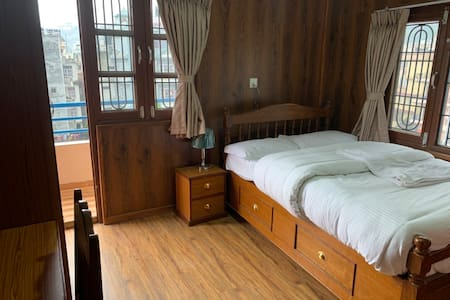 Private room with  Balcony at Nirmala Home stay