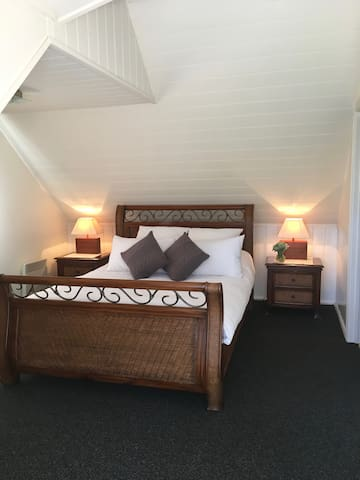beautiful light attic style bedroom with quality natural fibre linen