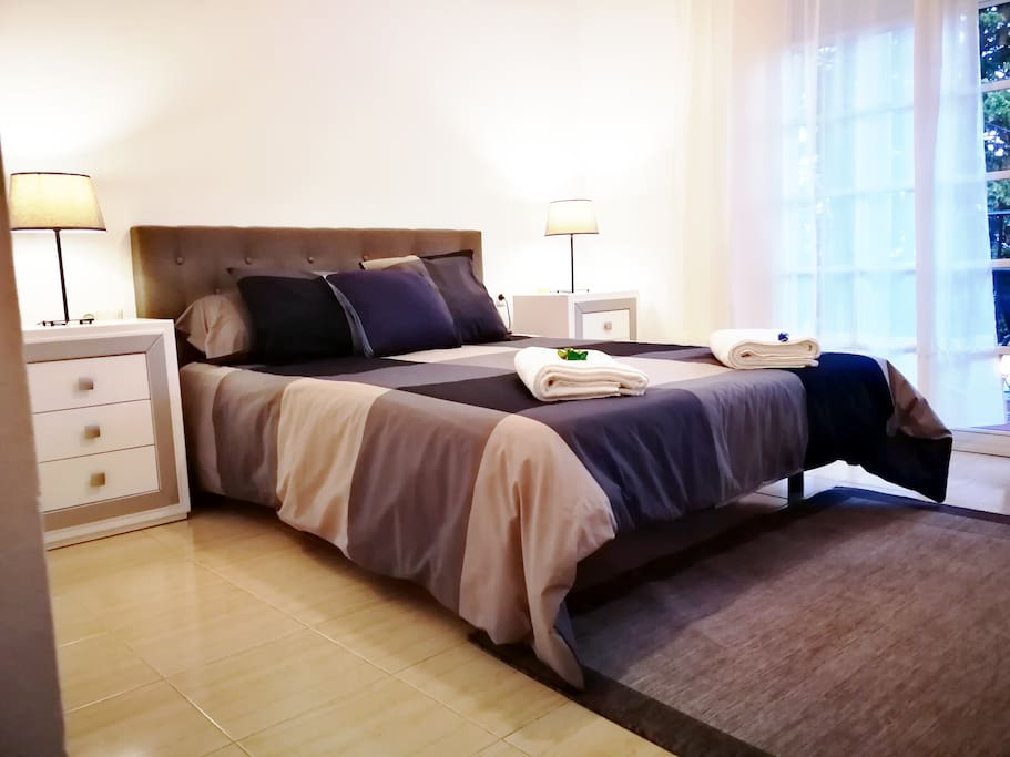 Main bedroom with queen size bed and private balcony