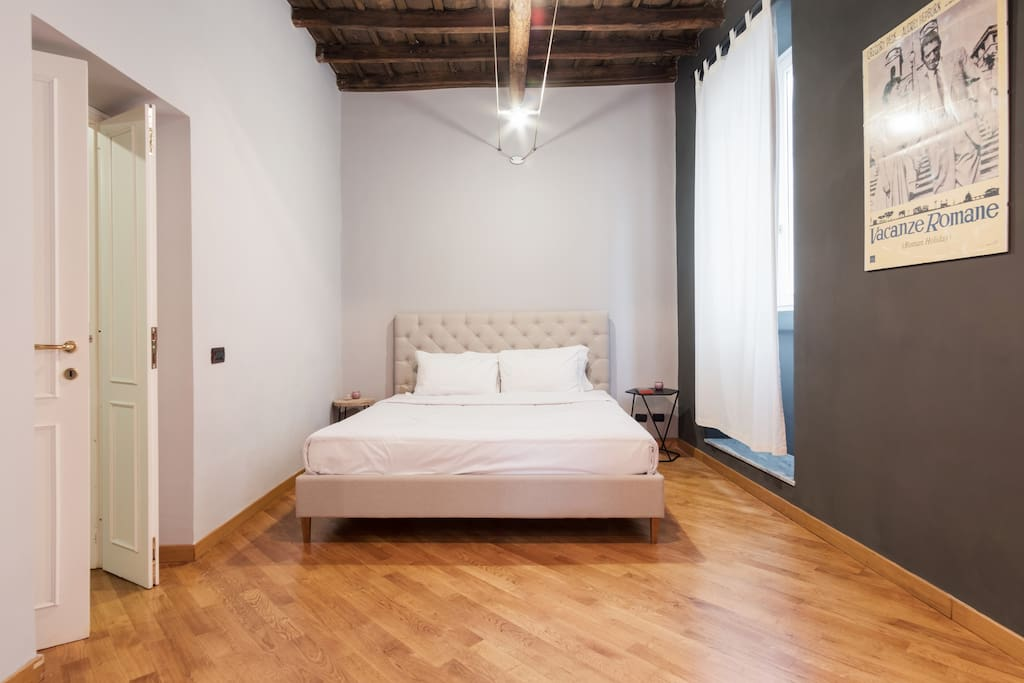 The master bedroom has windows with views of via del Governo Vecchio