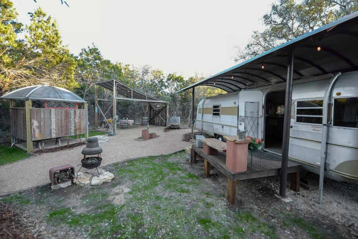private area with an outdoor shower and covered picnic area, chiminea, and BBQ grill