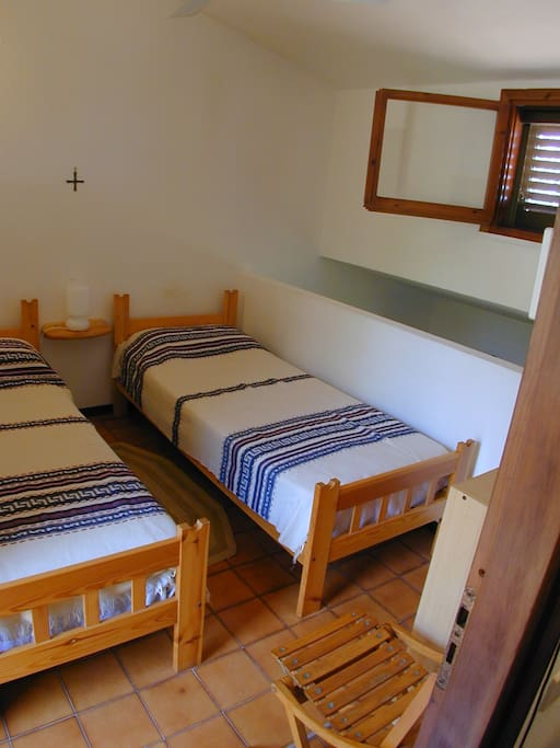 Master bedroom with 2 single beds or 1 double bed.
