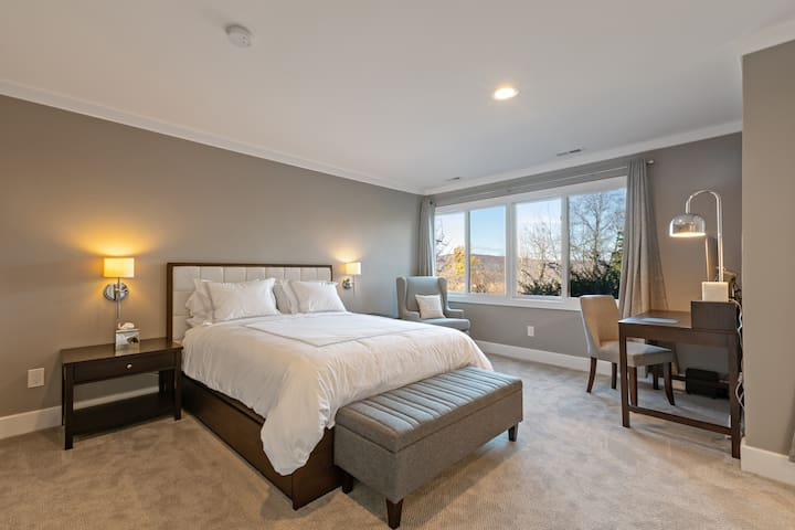 Downstairs master bedroom with queen storage bed and Saatva luxury firm mattress