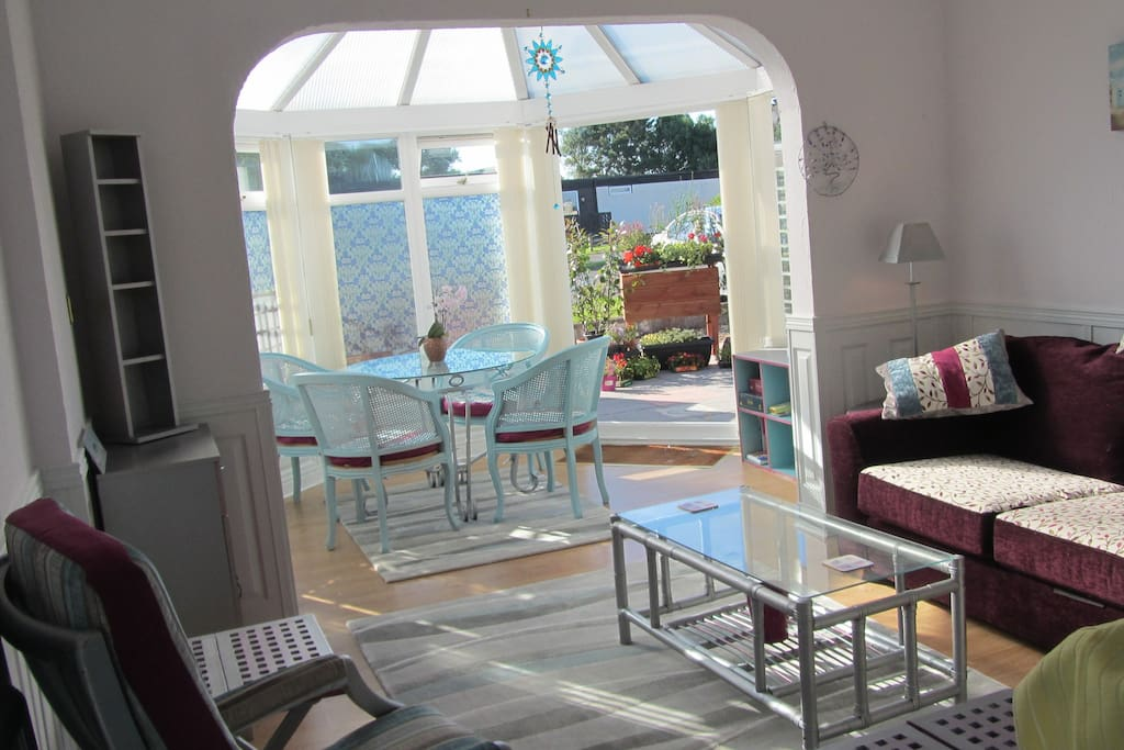 Lovely open plan living area with sun lounge leading to patio