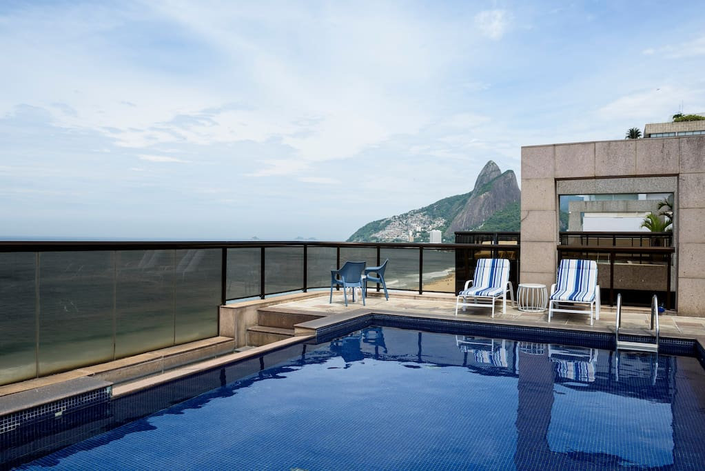 Rooftop swimming poll . Pedra da Gávea and Ipanema Beach sight seeing.
