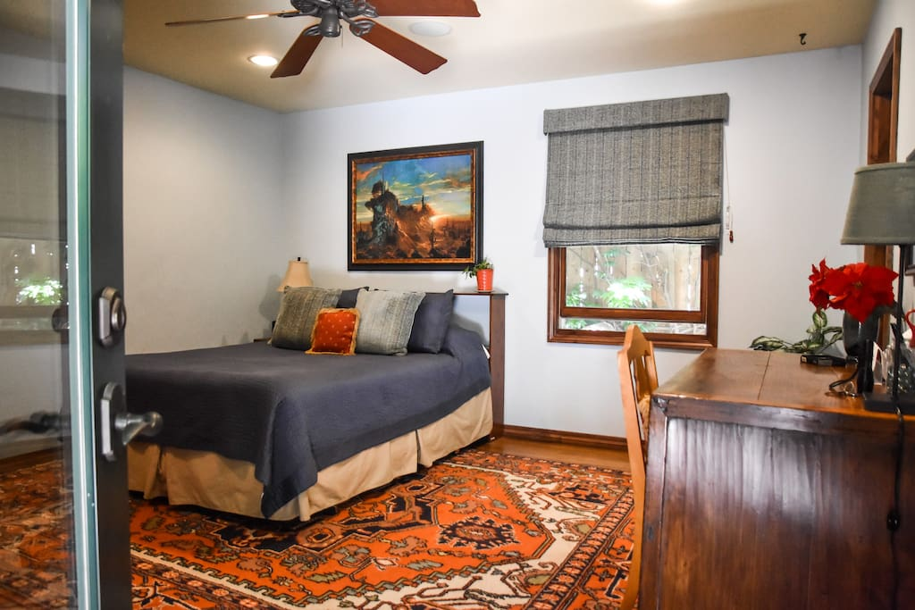 The inviting bedroom has its own entrance from the back yard so come and go as you please. Includes queen size bed, private bath with shower, flat screen TV, desk, and walk-in closet.