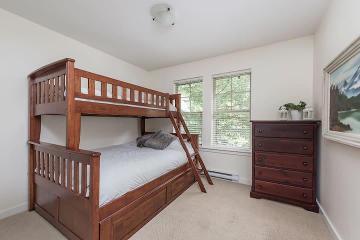 Main floor bedroom with bunk beds