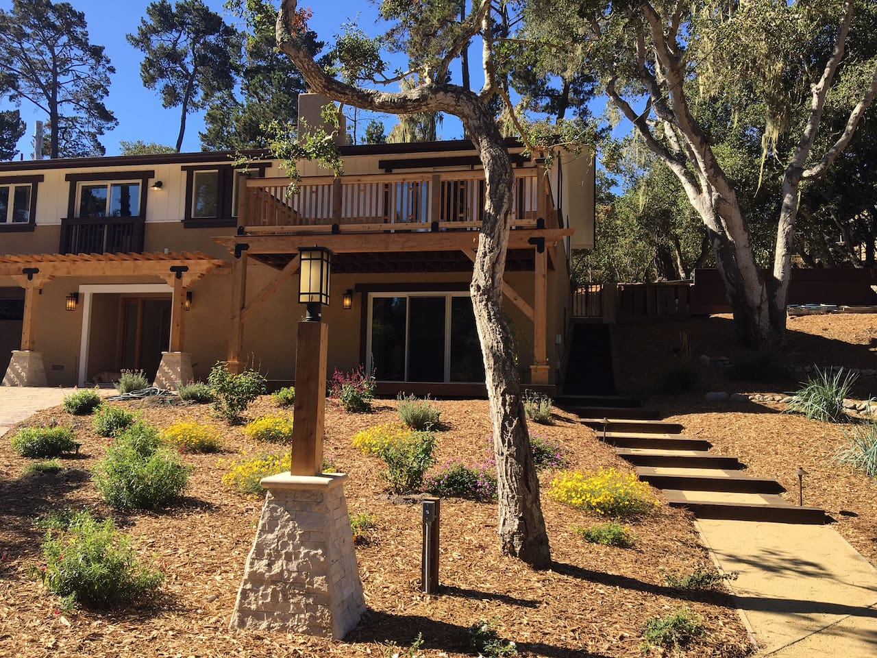 The path leads up to the apartment, enter through the sliding glass doors.