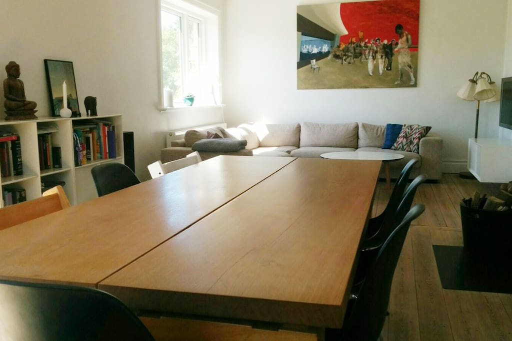 Living and dining room with large 8 persons dining table.
