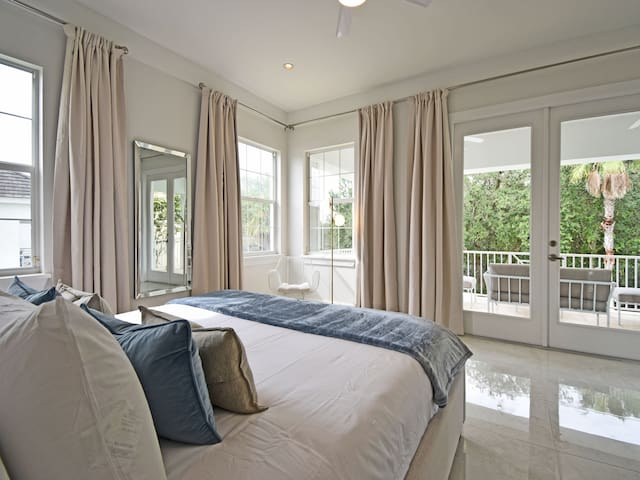 The master suite has a large terrace and overlooks the pool deck and natural conservation area.