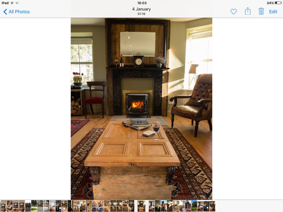 Victorian fireplace surrounds a wood burning stove .