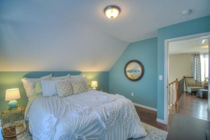 Upstairs Bedroom with Queen bed, side tables and access to full bathroom