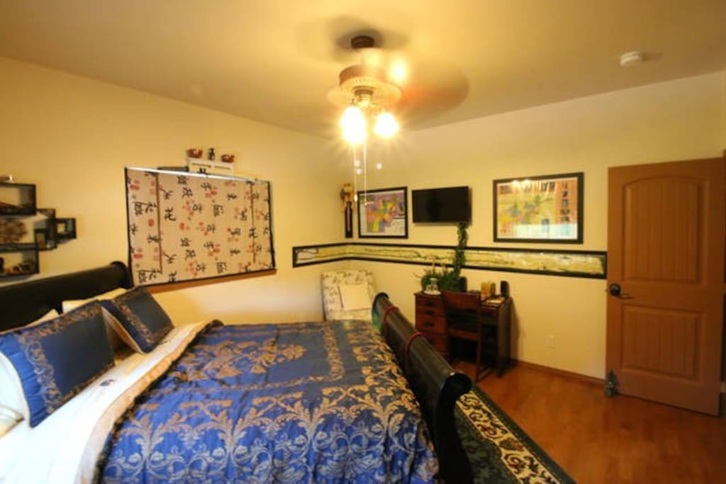 The Eastern room has a writing desk, smart TV, easy chair and wonderful bed.