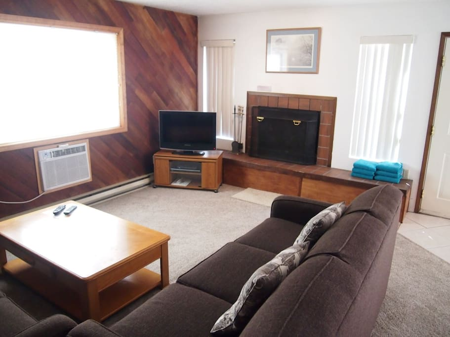 Living Room with fire place and flat screen