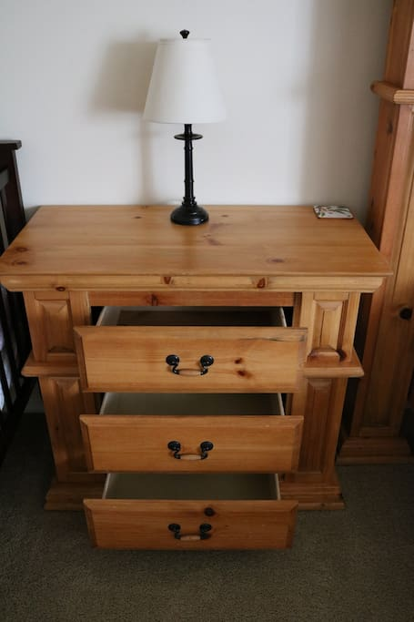 Large nightstand / small dresser available for use- lamp and three empty drawers