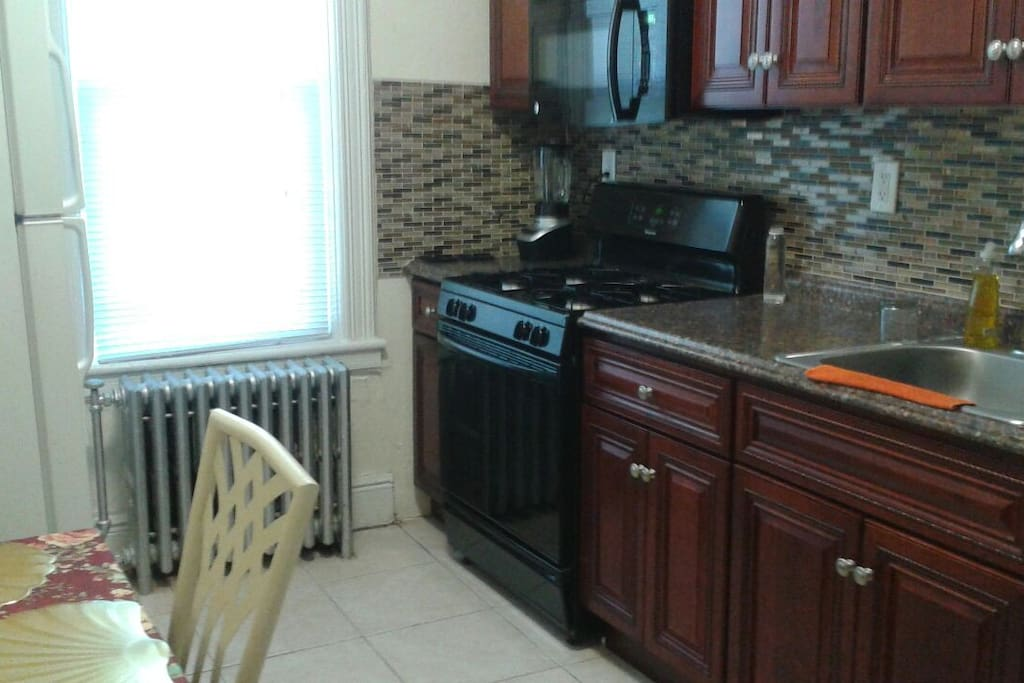 Full eat in kitchen with utensils, dishes, fridge, microwave, coffee maker, blender, pots The table is expandable and 4 chairs You have plenty of space to store food and cook a meal or breakfast.