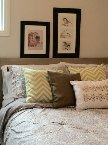 Master bedroom, queen bed with all linens, pillows and extra blankets. bedside tables on each side with small lamp.  small closet with hangers and shelves.
