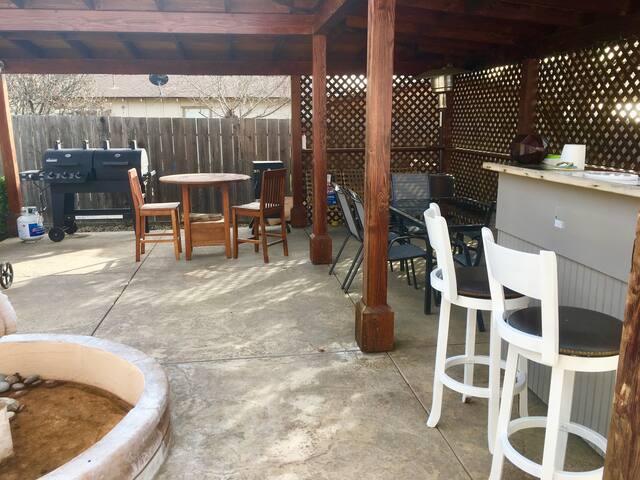 Back patio - bar, tables, BBQ