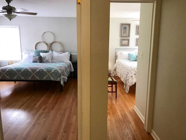Side by side view of King Room and Queen Room, hardwood floors throughout.  Additional design elements being added daily!