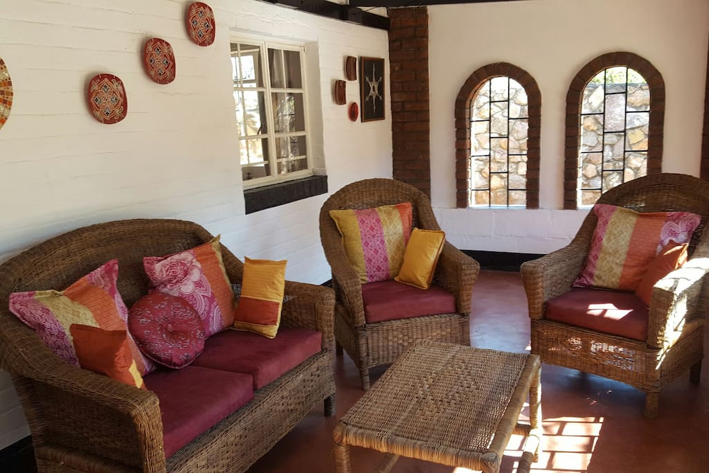 Enclosed, secure veranda, leading off the dining/lounge area, overlooking the garden, perfect for early morning coffee or evening sundowners.