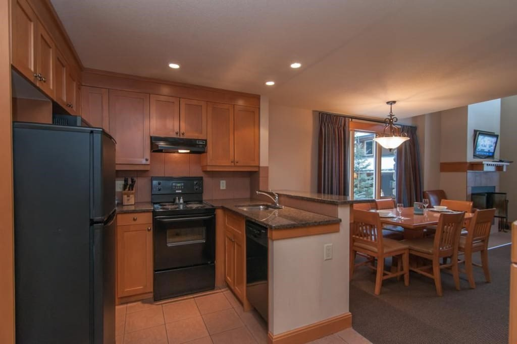 The open-plan kitchen and dining area feature modern amenities.