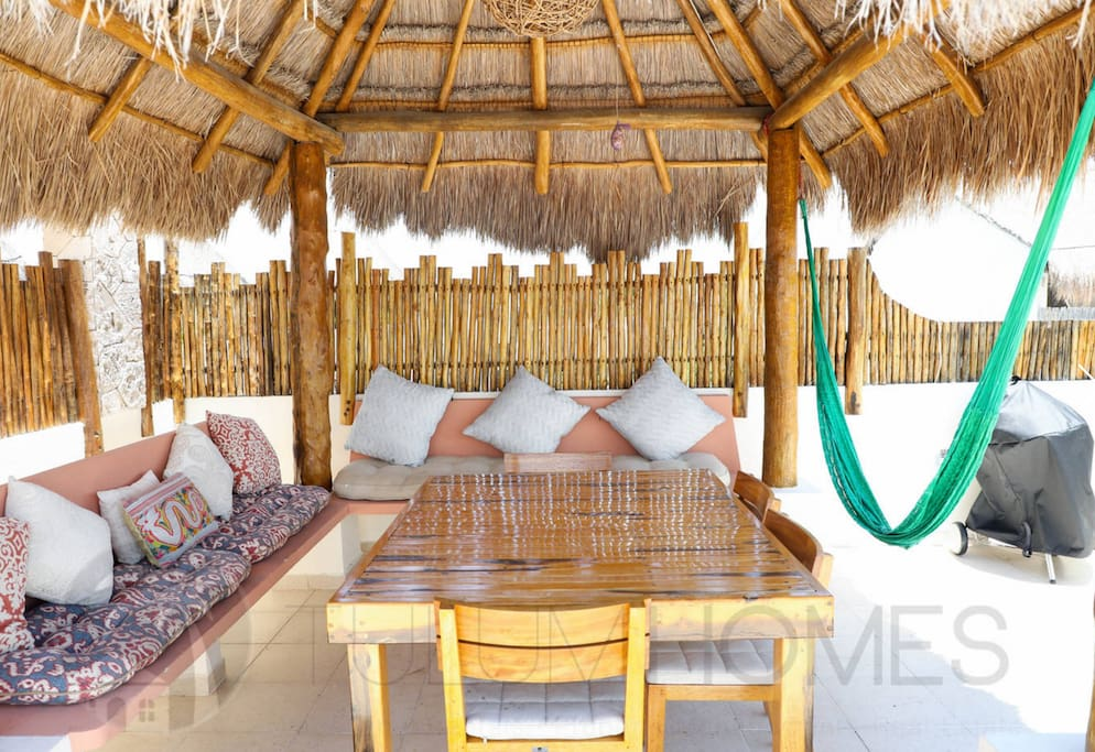 Take shelter from the sun under your own private palapa