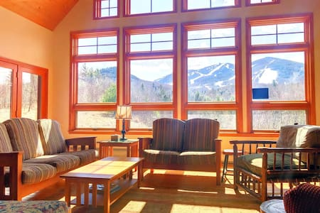 54POV: Stunning home at the base of Cannon Mountain/Franconia Notch! Beautiful Patio with fire pit, gorgeous fireplace, pool table, foosball! PROFESSIONALLY CLEANED!