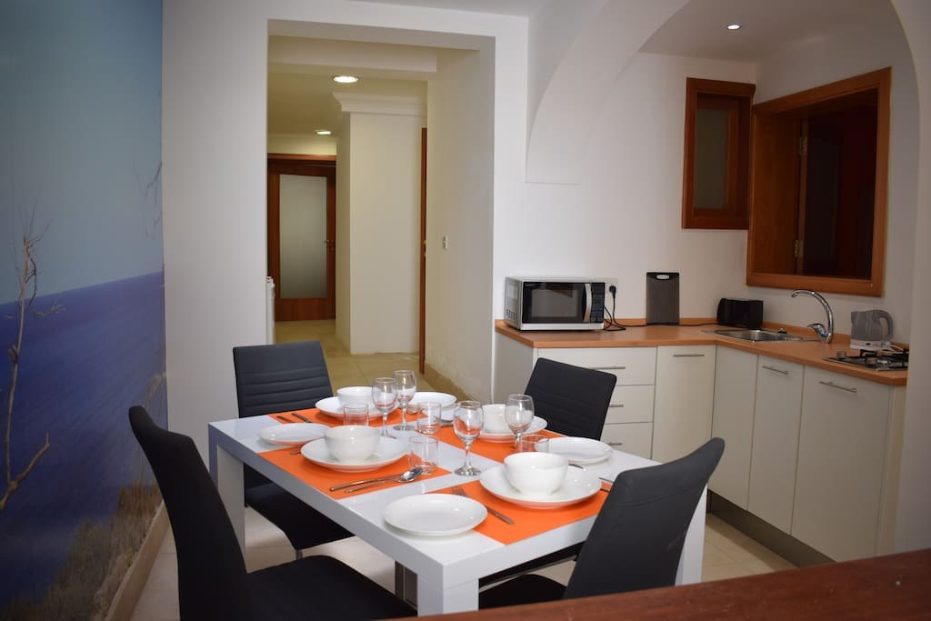 First to meet the eye is the fully equipped kitchen and dining area