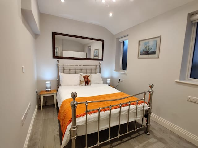 Main Bedroom with double bed, ergonomic mattress, Bedside table, touch lamps, wardrobe