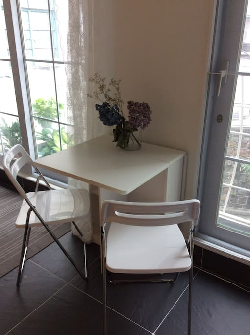 Dining table opens up if more space required