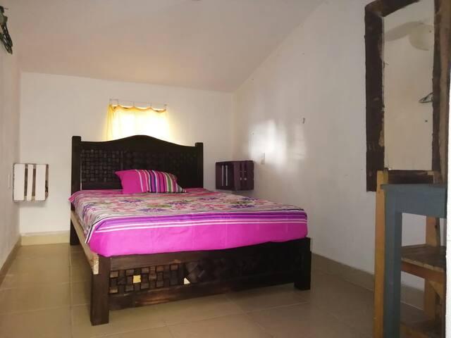 Linda habitación en Casa Atardecer ubicación centr