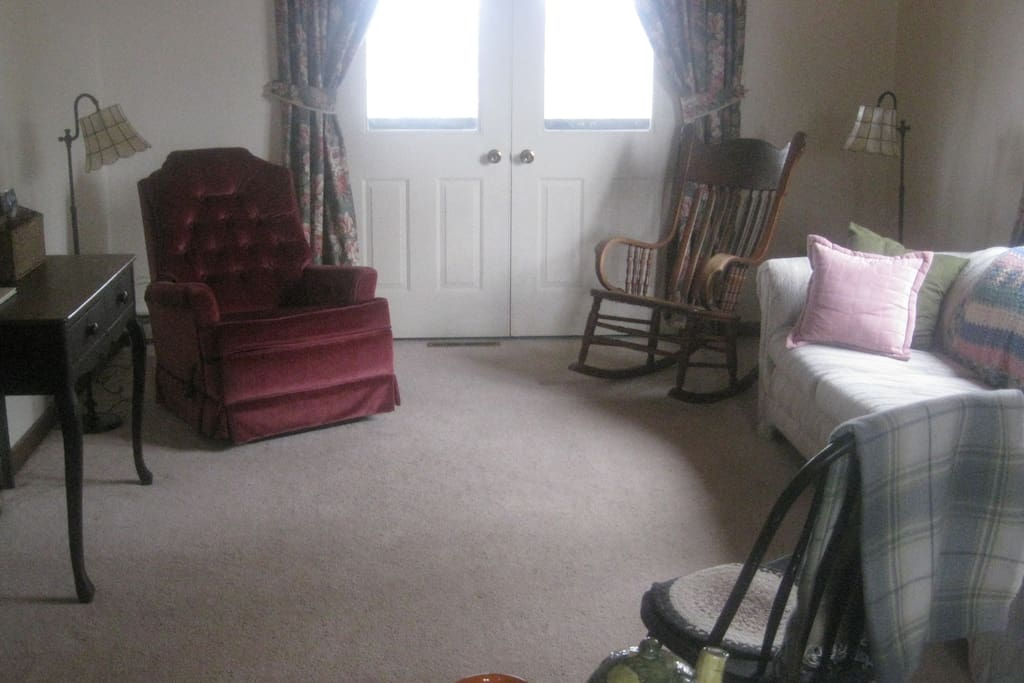 Living room, door to deck, queen sized sofa bed.