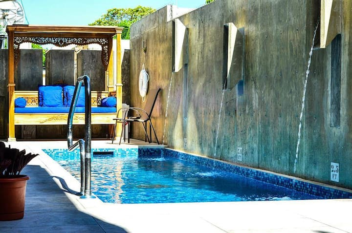 Boutique Hotel stay with private pool & roof deck!