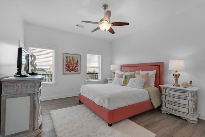 Mojo's second master suite on the third floor featuring furniture that has been hand-painted by a local artist to create the perfect beach house vibe.