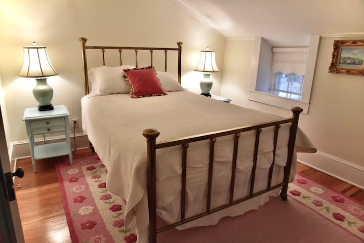 A queen sized antique brass bed graces the third bedroom that shares a bathroom.