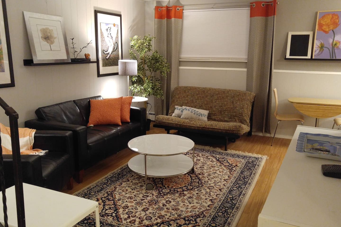 Living room with cable TV, Wifi and futon that sleeps 2. Extra table may be used as a work space.