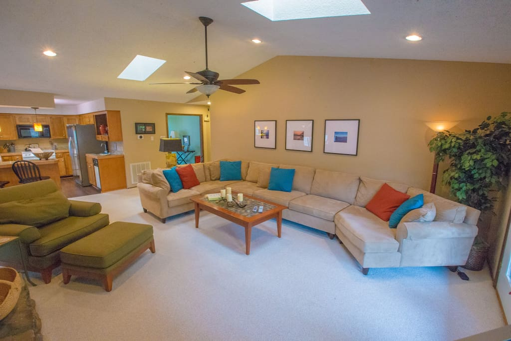 The sofa is HUGE! Also features a queen sleeper! Two skylights and a ceiling fan add to this great room!