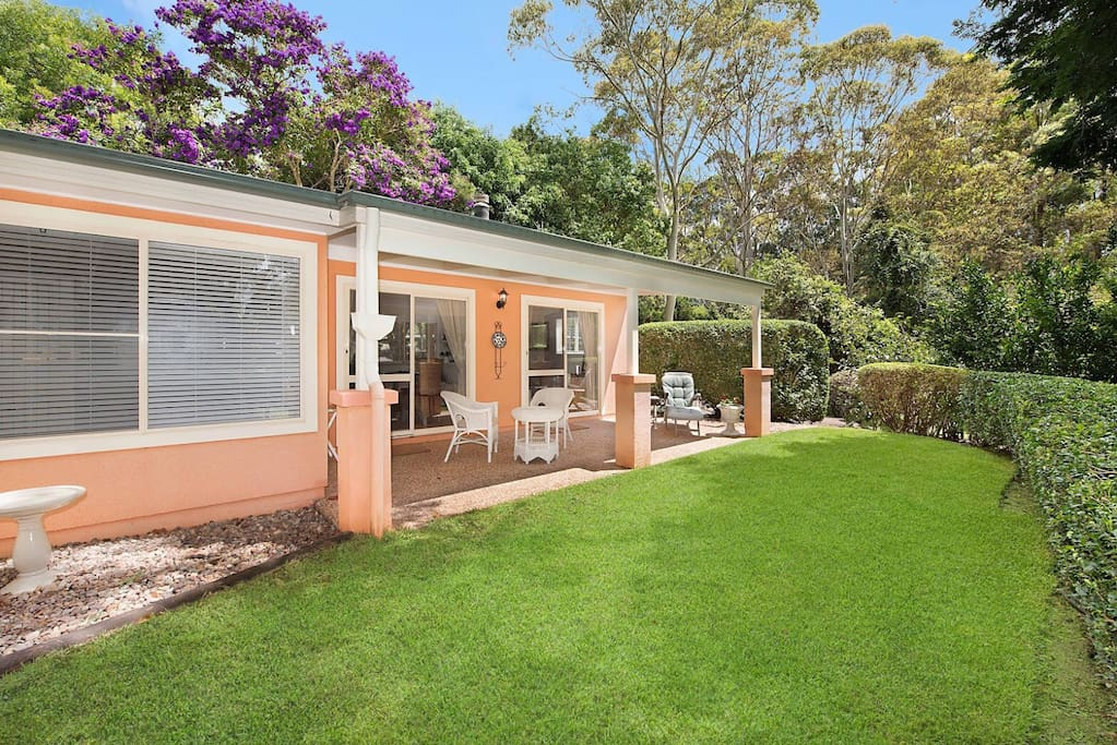 Private North facing covered courtyard looking out to private acreage gardens and paddocks.