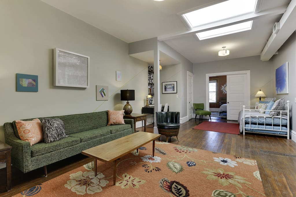 Welcome home!  You'll find large rooms, tall ceilings, and a retro influenced style. Living room has vintage furniture, cozy wool rug and original art. Relax after a hard day of Super Bowl LII activities!
