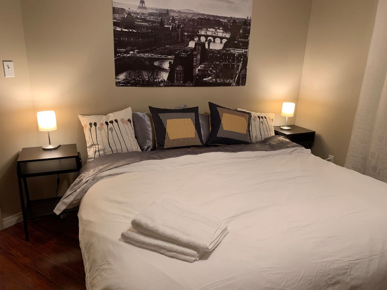 King Master bedroom, with a full length closet, and an AC system. We've added some night tables and pot lights recently for your comfort.
