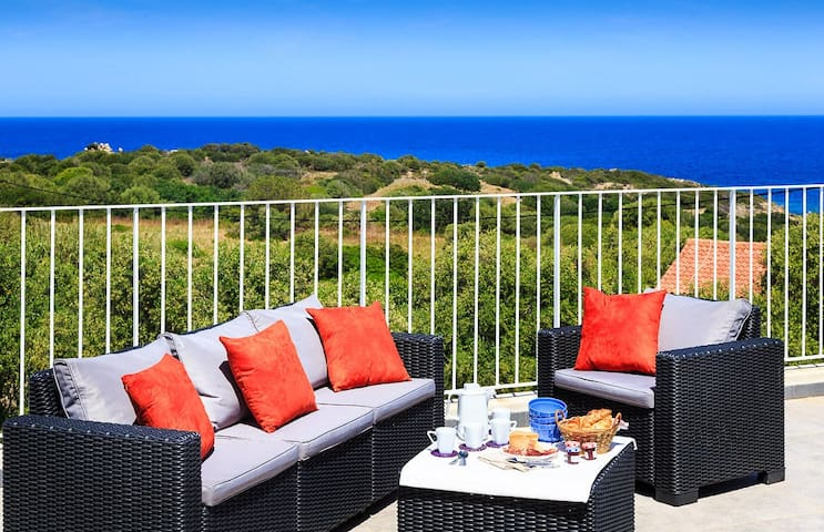 Stylish and contemporary 4 bedroom villa, with air con, wifi, a private heated pool, 10 minutes walk from the beach