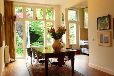 Spacious apartment with lush garden