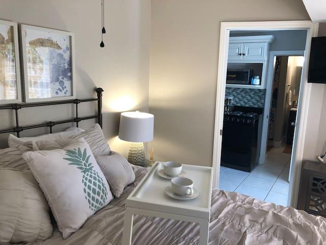Bedroom with queen bed.  Pocket door slides shut for privacy.