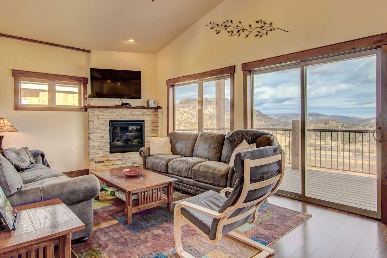 This 3-bedroom, 3-bath vacation rental home boasts amazing mountain vistas!