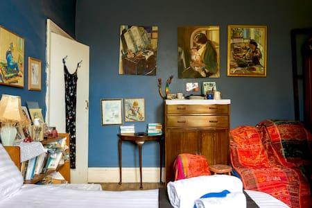 Artist's cluttered bedroom in West Yorkshire