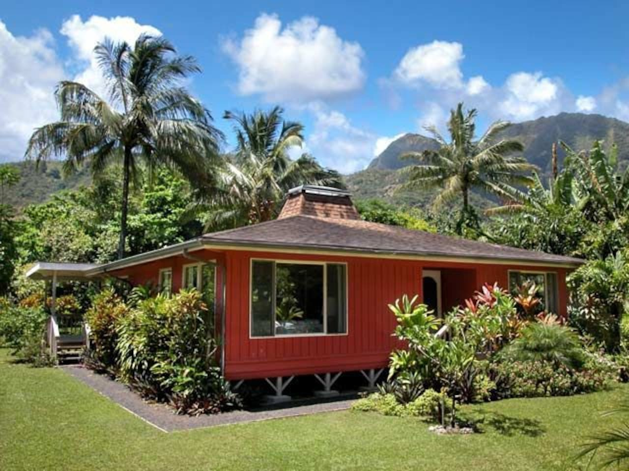 Traditional Hawaiian style cottage with privacy landscaping and waterfall views