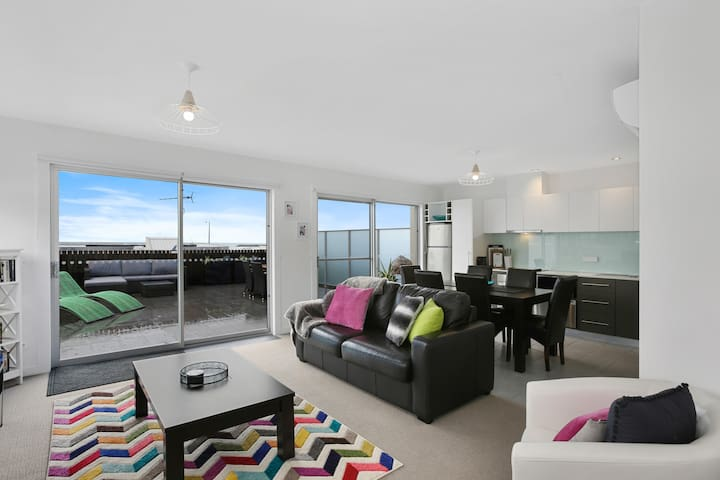 Modern Penhouse Apartment - Access to a huge private terrace with ocean views.
